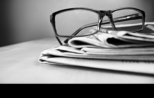 glasses resting on newspaper